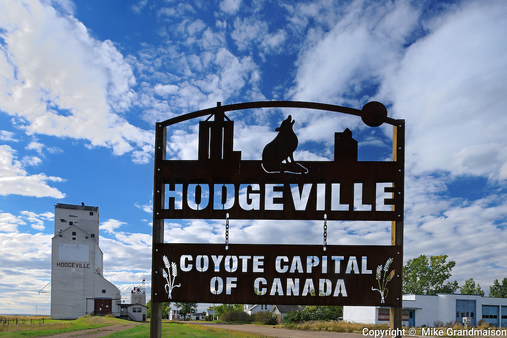 Grain elevator and town sign<br /> Hodgeville<br /> Saskatchewan<br /> Canada
