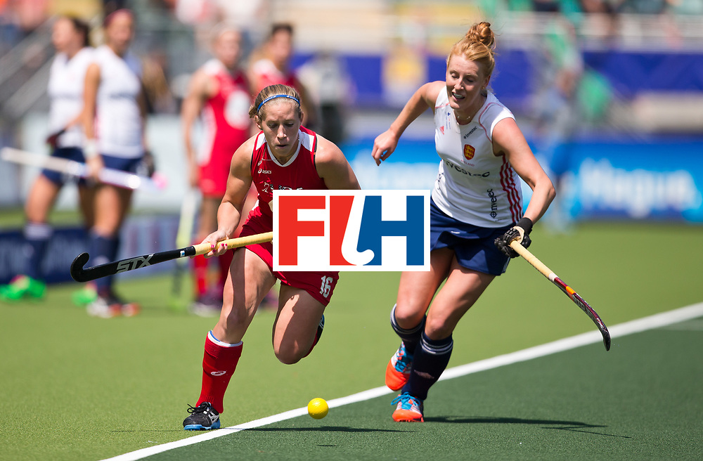 Hockey World Cup 2014<br /> The Hague, Netherlands <br /> Day 2 Women England v USA<br /> Katie O'Donnell of the USA (L) and Susie Gilbert of England do battle on day 2<br /> Photo: Grant Treeby<br /> www.treebyimages.com.au