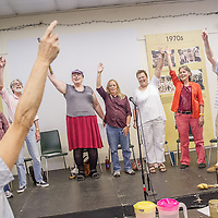 "Rhea, far left, directs LGBT members of *eRa* , a senior writing group at the Q Center in Portland, during warm-ups before rehearsing ""Speaking Out at Last: Stories from the LGBTQ Community"", a narrative theater piece chronicling experiences of childhood, first love, homophobia, AIDS, and aging. Speakers from left, Signe, Vern, Jamie, Ricky, Sheila, program director Susan Kocen, and Jim.11:11am"