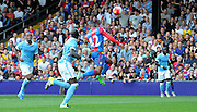 Jason Puncheon leaps high for a headed chance during the Barclays Premier League match between Crystal Palace and Manchester City at Selhurst Park, London, England on 12 September 2015. Photo by Michael Hulf.