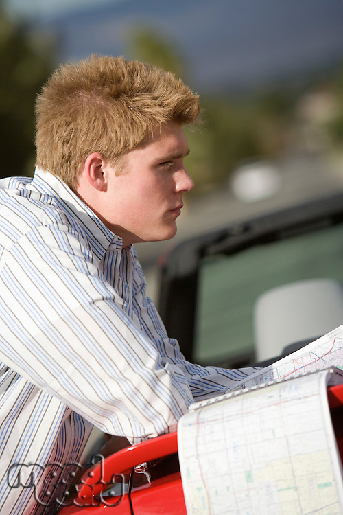 Man Looking at Road Map