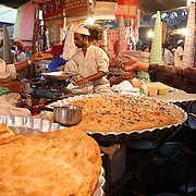 On the last day of the Ramadan, a temporary food stall is set up near the gate of the jama masjid in Old Delhi to sell Halwa Paratha, a famouse sweet delight, to the people coming out of the mosque after the break of the fast.