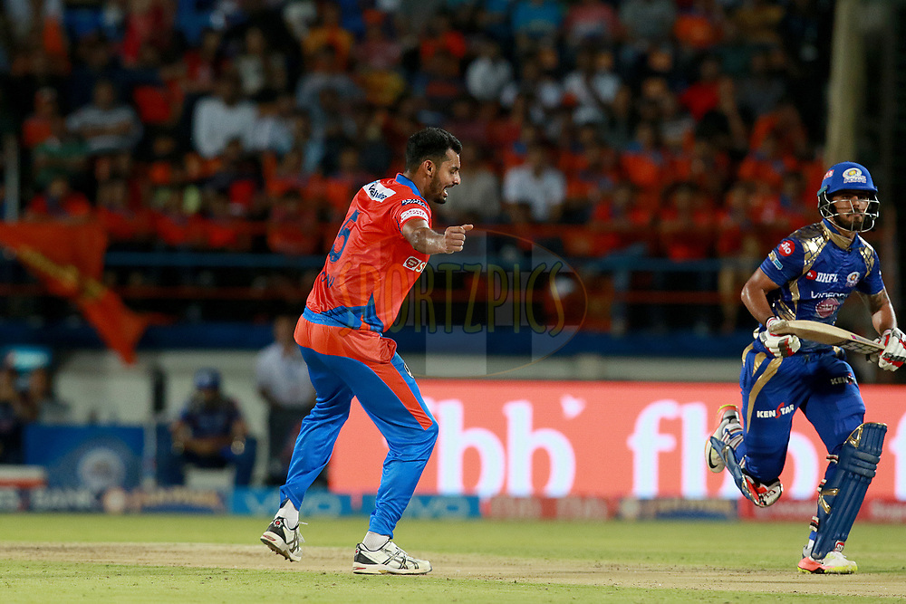 Ankit Soni of GL celebrates after takes a wicket of Nitish Rana of MI during match 35 of the Vivo 2017 Indian Premier League between the Gujarat Lions and the Mumbai Indians  held at the Saurashtra Cricket Association Stadium in Rajkot, India on the 29th April 2017<br /> <br /> Photo by Rahul Gulati - Sportzpics - IPL