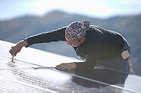A man working with hills in the background