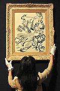 © Licensed to London News Pictures. 02/02/2012, London, UK. A gallery assistant hangs Marc Chagall's 'Nu de chapeau ou le fauna'. The painting is expected to fetch 30,000-50,000GBP. Photo call at Bonhams, London for Impressionist and Modern Art Auction preview..  Photo credit : Stephen Simpson/LNP