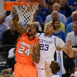 Mar 31, 2012; New Orleans, LA, USA; Louisville Cardinals forward Chane Behanan (24) goes for the tip in as Kentucky Wildcats forward Anthony Davis (23) defends during the first half in the semifinals of the 2012 NCAA men's basketball Final Four at the Mercedes-Benz Superdome. Mandatory Credit: Derek E. Hingle-US PRESSWIRE