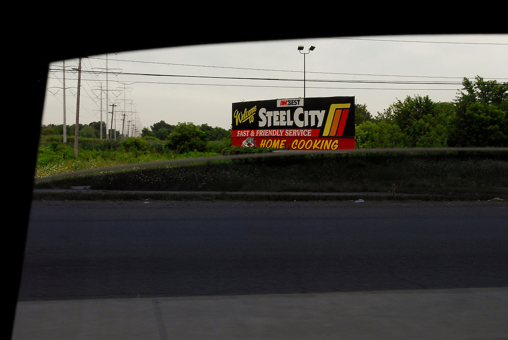 """A roadside announces """"Welcome to the City of Steel"""" in Gary, Indiana. The city of 100,000 was founded in 1906 by the U.S. Steel Corporation as the home for its new plant. but in the 1960s Gary's fortunes took a downturn. Businesses closed and the crime rate spiraled earning Gary the infamous distinction of """"Murder Capital of America."""" African Americans, which make up 85% of Gary's population face high rates of joblessness with the unemployment rate for black males at 18%."""