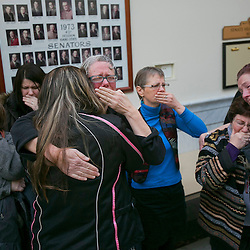 "Former Idaho State Senator Nicole LeFavour (middle, facing camera) gets a hug from Carmen Stanger as Judy Cross (right, stripes) and Julie Zicha (far right) console each other in a hallway at the Idaho Capitol after the House State Affairs Committee voted down H002 (Sexual orientation, gender identity). Idaho's House State Affairs Committee voted 13-4 on Thursday morning to defeat a bill that would have added the words ""sexual orientation"" and ""gender identity"" to Idaho's Human Rights Act. The vote fell along party lines. Thursday January 29, 2015"