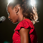 June 22, 2009 - Bronx, NY : PS81, the Robert J. Christen School, held its 5th grade closing ceremony on Monday morning.  PS81 graduate Christina Williams performs a reading.  Williams also won a sport prize.
