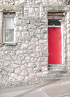 a red door on a stone building in downtown Seattle, Washington, USA graphic effect