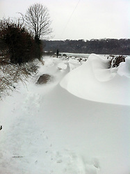 © London News Pictures. 11/03/2013 . Upper Halling, UK.  Snow drifts on a country road in Upper Halling, Kent following heavy snowfall over night. Photo credit : Dave Gilbert/LNP