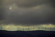 Wind turbines at dusk with stormy clouds background Photographed on Cephalonia, Ionian Islands, Greece