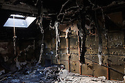 The interior of an appartment inside the Kaddafi residence in Bab Al Aziziya, the stronghold in center tripoli, looted and burn during the civil war.