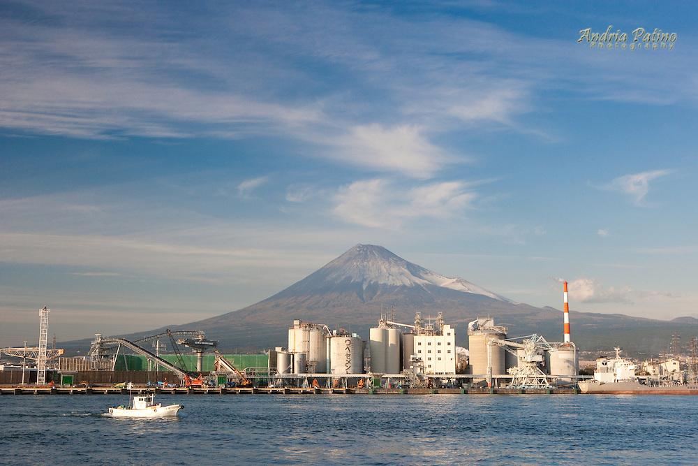 Mount Fuji behind industrial harbor, Japan