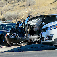 A mangled sedan sits with airbags deployed at the Aztec and Highway 602 intersection in Gallup Thursday.  The vehicle collided with a pickup truck after 2 p.m..