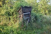 Collapsed outdoor toilet shack in overgrown land at Bakonygyirot, Gyor-Moson-Sopron, Hungary