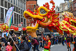 © Licensed to London News Pictures. 26/01/2020. LONDON, UK.  A dragon dance takes place during a parade as part of the Chinese New Year celebrations in Chinatown to celebrate the Year of the Rat.  Chinese New Year in the capital draws hundreds of thousands of Londoners and tourists and is the biggest such celebration outside Asia.  This year's event takes place in the shadow of an outbreak of the coronavirus in Wuhan, China, which has so far claimed the lives of 56 people.  Photo credit: Stephen Chung/LNP