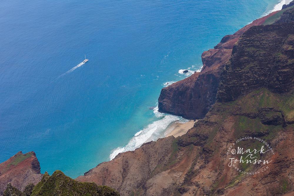 Tour boat off of Honopu Beach & Valley, Na Pali Coast, Kauai, Hawaii