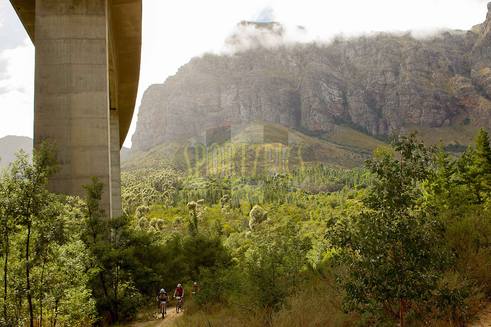 Riders pass under the N1 highway bridge during stage 6 of the 2013 Absa Cape Epic Mountain Bike stage race from Wellington to Stellenbosch, South Africa on the 23 March 2013..Photo by Greg Beadle/Cape Epic/SPORTZPICS