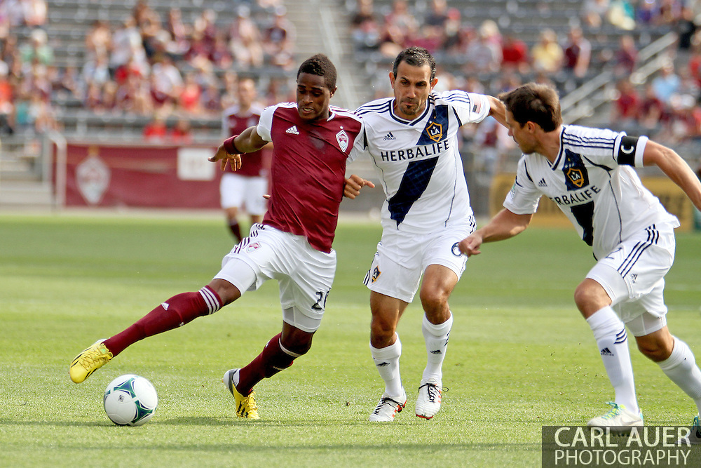 July 27th, 2013 - Colorado Rapids forward Deshorn Brown (26) attempts to get past LA Galaxy midfielder Pablo Mastroeni (6) in first half action of the Major League Soccer match between the LA Galaxy and the Colorado Rapids at Dick's Sporting Goods Park in Commerce City, CO
