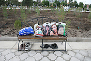 Plastic bags on a bench in a public garden in Samarkand