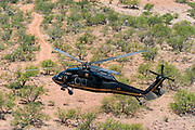 02 JUNE 2006 - NOGALES, ARIZONA: A Black Hawk helicopter operated by Immigration and Customs Enforcement (ICE) flies an anti-immigrant patrol over the desert between Nogales, AZ and Tucson, AZ.      PHOTO BY JACK KURTZ