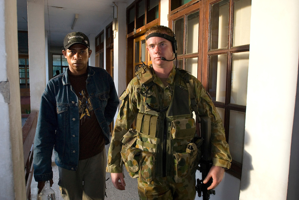 Jose Sarmento (26), one of Major Alfredo Reinado's Rebels, or Petitioners as they prefer to be known, is led away to a holding cell after appearing in  court in Dili. Sarmento was arrested in the company of his friend, an Australian woman, Leilani Gaze (21) visiting from Byron Bay, NSW.
