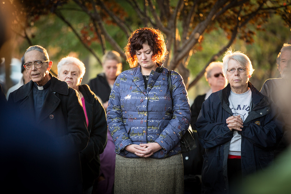 "Lisa Johnston | lisajohnston@archstl.org  | Twitter: @aeternusphoto  Archbishop Robert J. Carlson led prayers for the ""Faith in Ferguson"" prayer vigil for peace Nov. 5 at January-Wabash Park in Ferguson.  Priests, deacons, seminarians and relgious women and men were among about 150 people who prayed the Rosary and offered a prayer to Our Lady, Undoer of Knots. ""We are hear to pray for peace, to acknowledge... we need to turn to the Lord and ask God, with the poew He can bring to any situation, to bring about healing,"" Archbishop Carlson said.  ""we want to pray that there is healing... Praying day in and day out is a must.""  This was the second of three archdiocesan prayer gatherings for Ferguson.  The next vigil will be Dec. 1.  Founder of the Society of Our Mother of Peace Father Placid Guste, Meg Olson from Catholic Charities and Ginny Schrappen a parishioner at Mary Mother of the Church prayed the rosary."