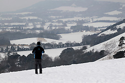 © Licensed to London News Pictures. 10/02/2012, London, UK.  A man looks down the valley from the snow covered North Down in Surrey, south London, as the cold weather continue to affect much of Britain. Friday, Feb. 10, 2012. Photo credit : Sang Tan/LNP