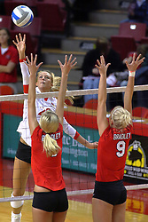 09 October 2009: Mallory Leggett attacks defenders Megan Schmidt and Skylar Lesan. The Redbirds of Illinois State defeated the Braves of Bradley in 3 sets during play in the Redbird Classic on Doug Collins Court inside Redbird Arena in Normal Illinois