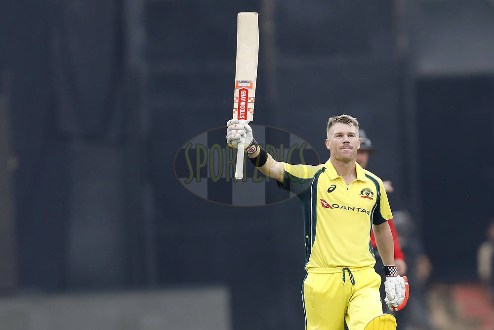 David Warner of Australia celebrates his Hundred runs during the 4th One Day International between India and Australia held at the M. Chinnaswamy Stadium in Bengaluru on the 28th  September 2017<br /> <br /> Photo by Arjun Singh / BCCI / SPORTZPICS
