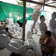 May 14, 2013 - Mandalay, Myanmar: Local women sand buddha statues in a traditional workshop, in Mandalay, dedicated to the production of religious paraphernalia. CREDIT: Paulo Nunes dos Santos