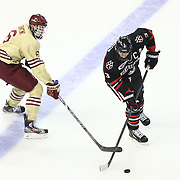 Josh Manson #3 of the Northeastern Huskies keeps the puck from Steven Santini #6 of the Boston College Eagles during The Beanpot Championship Game at TD Garden on February 10, 2014 in Boston, Massachusetts. (Photo by Elan Kawesch)