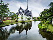 16 JULY 2014 - SAMUT PRAKAN, SAMUT PRAKAN, THAILAND: A reconstruction of the Sanphet Prasat Throne Hall from Ayutthaya at Ancient Siam. The original was destroyed by the Burmese when they ransacked Ayutthaya in 1767. Ancient Siam is a historic park about 200 acres (81 hectares) in size in the city of Samut Prakan, province of Samut Prakan, about 90 minutes from Bangkok. It features historic recreations of important Thai landmarks and is shaped roughly like the country of Thailand.      PHOTO BY JACK KURTZ