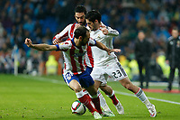 Real Madrid´s Isco (R) and Atletico de Madrid´s Arda Turan and Juanfran during Spanish King´s Cup match at Santiago Bernabeu stadium in Madrid, Spain. January 15, 2015. (ALTERPHOTOS/Victor Blanco)