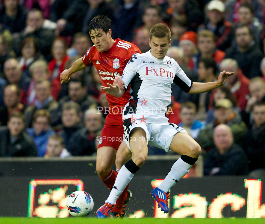 LIVERPOOL, ENGLAND - Tuesday, May 1, 2012: Liverpool's Martin Kelly in action against Fulham's Alex Kacaniklic during the Premiership match at Anfield. (Pic by David Rawcliffe/Propaganda)