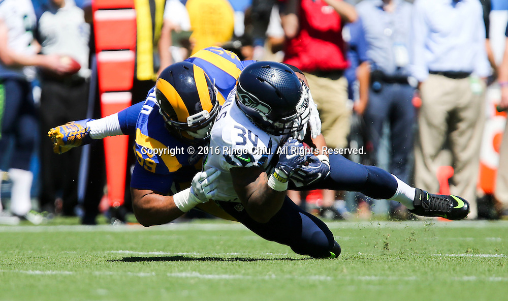 Seattle Seahawks running back Thomas Rawls (34) is tackled by Los Angeles Rams defensive tackle Aaron Donald (99) during a NFL football game, Sunday, Sept. 18, 2016, in Los Angeles. The Rams won 9-3.(Photo by Ringo Chiu/PHOTOFORMULA.com)<br /> <br /> Usage Notes: This content is intended for editorial use only. For other uses, additional clearances may be required.