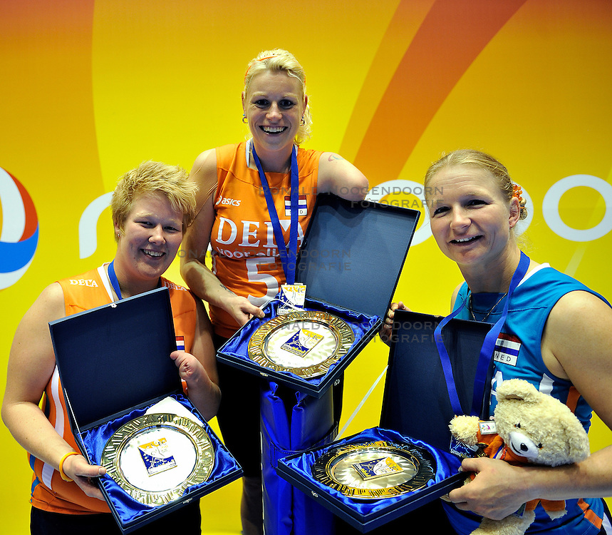 15-10-2011 VOLLEYBAL: EUROPEAN CHAMPIONSHIP SITTING VOLLEYBALL FINAL NETHERLANDS - UKRAINE: ROTTERDAM<br /> (L-R) Marieke de Ruijter, Karin van der Haar, best spiker and Paula List best receiver<br /> &copy;2011-FotoHoogendoorn.nl