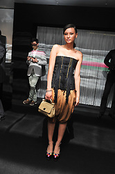 LEAH WELLER at a party to launch the Gucci designed Fiat 500 customized by Gucci Creative Director Frida Giannini in collaboration with FIAT's Centro Stile, held at Fiat, 105 Wigmore Street, London on 27th June 2011.