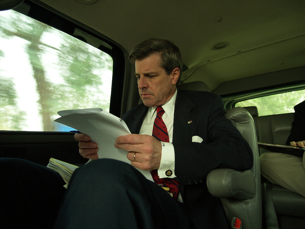 22 April 2004....Baghdad, Iraq.....Paul Bremer.....US Ambassador to Iraq Paul Bremer has been in counrty for almost one year. His day starts early with briefings and is entirely taken up with meetings and press conferences. Even whilst being driven at great speed with a security detail that rivals the that of the US President  Mr Bremer continuse to work, reading incoming messages and discussing his schedule with aides. ..Meals are commonly eaten at his desk whislt still ploughing through an imense workload.....