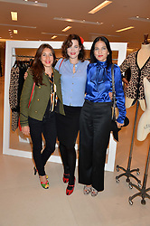 Left to right, LAUREN KEMP, JASMINE GUINNESS and YASMIN MILLS at the launch of the 'Jasmine for Jaeger' fashion collection by Jasmine Guinness for fashion label Jaeger held at Fenwick's, Bond Street, London on 9th September 2015.