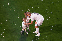 Real Madrid's player Pepe with his kids during the celebration of the victory of the Real Madrid Champions League at Santiago Bernabeu in Madrid. May 29. 2016. (ALTERPHOTOS/Borja B.Hojas)