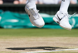 LONDON, ENGLAND - Wednesday, July 6, 2016: Roger Federer's  (SUI) shadow and  shoes during the Gentlemen's Single Quarter Finals match on day ten - of the Wimbledon Lawn Tennis Championships at the All England Lawn Tennis and Croquet Club. (Pic by Kirsten Holst/Propaganda)