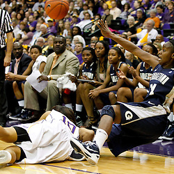 November 16, 2011; Baton Rouge, LA; Georgetown Hoyas guard Sugar Rodgers (14) passes after colliding with LSU Tigers guard Adrienne Webb (10) during the first half of a game at the Pete Maravich Assembly Center.  Mandatory Credit: Derick E. Hingle-US PRESSWIRE