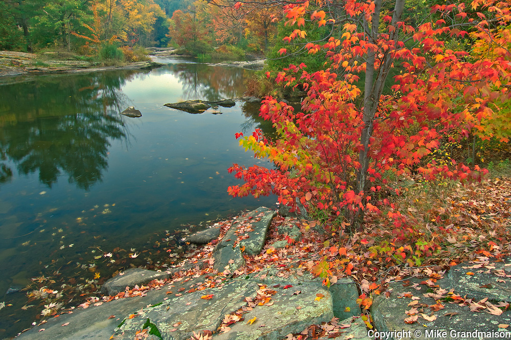 Autumn along the Skeleton River at Hatchery Falls. Muskoka Country.<br />