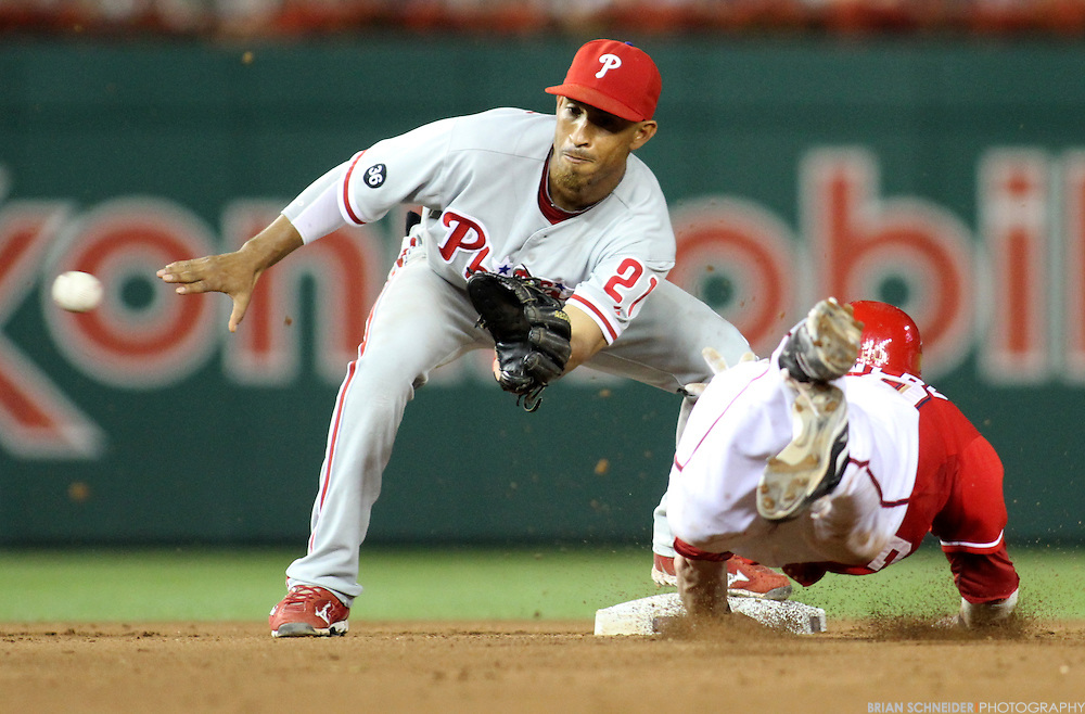 July 31, 2010; Washington, DC, USA; Philadelphia Phillies second baseman Wilson Valdez (21) tags out Washington Nationals second baseman Adam Kennedy (20) stealing second base at Nationals Park. Mandatory Credit: Brian Schneider-www.ebrianschneider.com