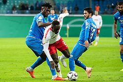 LEIPZIG, Nov. 1, 2018  Leipzig's Jean-Kevin Augustin (C) vies with Hoffenheim's Kasim Adams (L) and Leonardo Bittencourt during the 2nd round match of German Cup between RB Leipzig and TSG 1899 Hoffenheim, in Leipzig, Germany, on Oct. 31, 2018. Leipzig won 2-0. (Credit Image: © Kevin Voigt/Xinhua via ZUMA Wire)