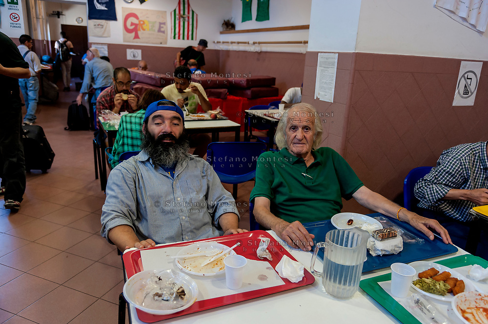 ROME, ITALY - AUGUST 15: A guest to the Caritas canteen at Colle Oppio in Rome  on the mid-August holiday on August 15, 2017 in Rome, Italy. Caritas canteen of Colle Oppio  provide about 500 meals a day for lunch.