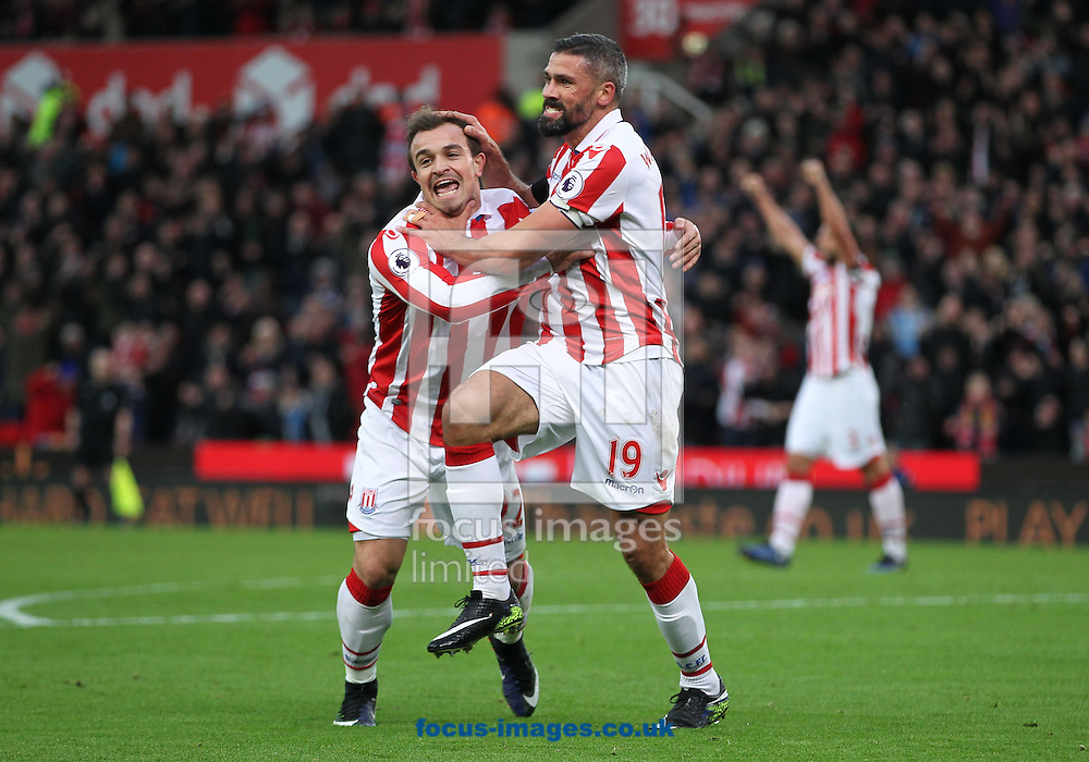 Jonathan Walters of Stoke City celebrates with Xherdan Shaqiri after scoring the first goal against Burnley during the Premier League match at the Bet 365 Stadium, Stoke-on-Trent.<br /> Picture by Michael Sedgwick/Focus Images Ltd +44 7900 363072<br /> 03/12/2016
