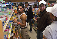 NEWS&GUIDE PHOTO / PRICE CHAMBERS.Most meals are eaten on the go as the mexican caravan pushes hard into the Great Plains on the first day of the journey. Gas stations serve a dual purpose, providing fuel for both the car and the driver.